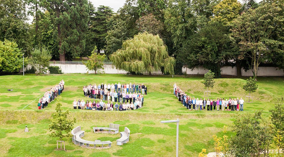 Deaf Community standing in DVI gardens – ISL
